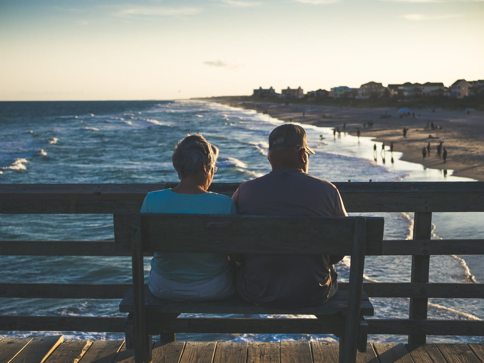 Couple in Retirement Enjoying a View of the Beach from a Pier